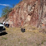 Sampling Mexican Hat's gold-bearing hematite mineralization, east side of hill